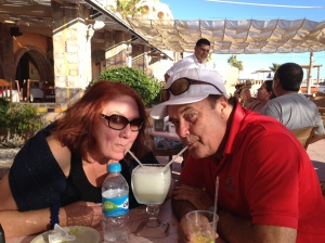 Donna and Jack sharing a double margarita on the hotel patio