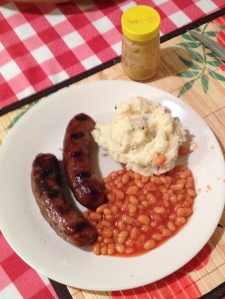 Bangers and mash and baked beans, a traditional English dinner