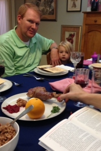 Nick and Savy look on as Elissa explains the Seder plate.