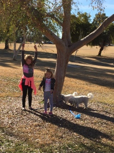 Throwing leaves up in the air in the park.