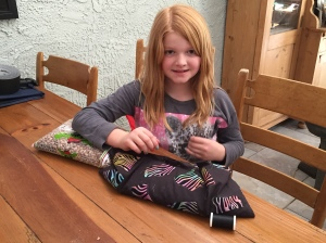 Abby hand sewing a homeopathic body warmer