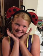 Abby tries on ladybug headband